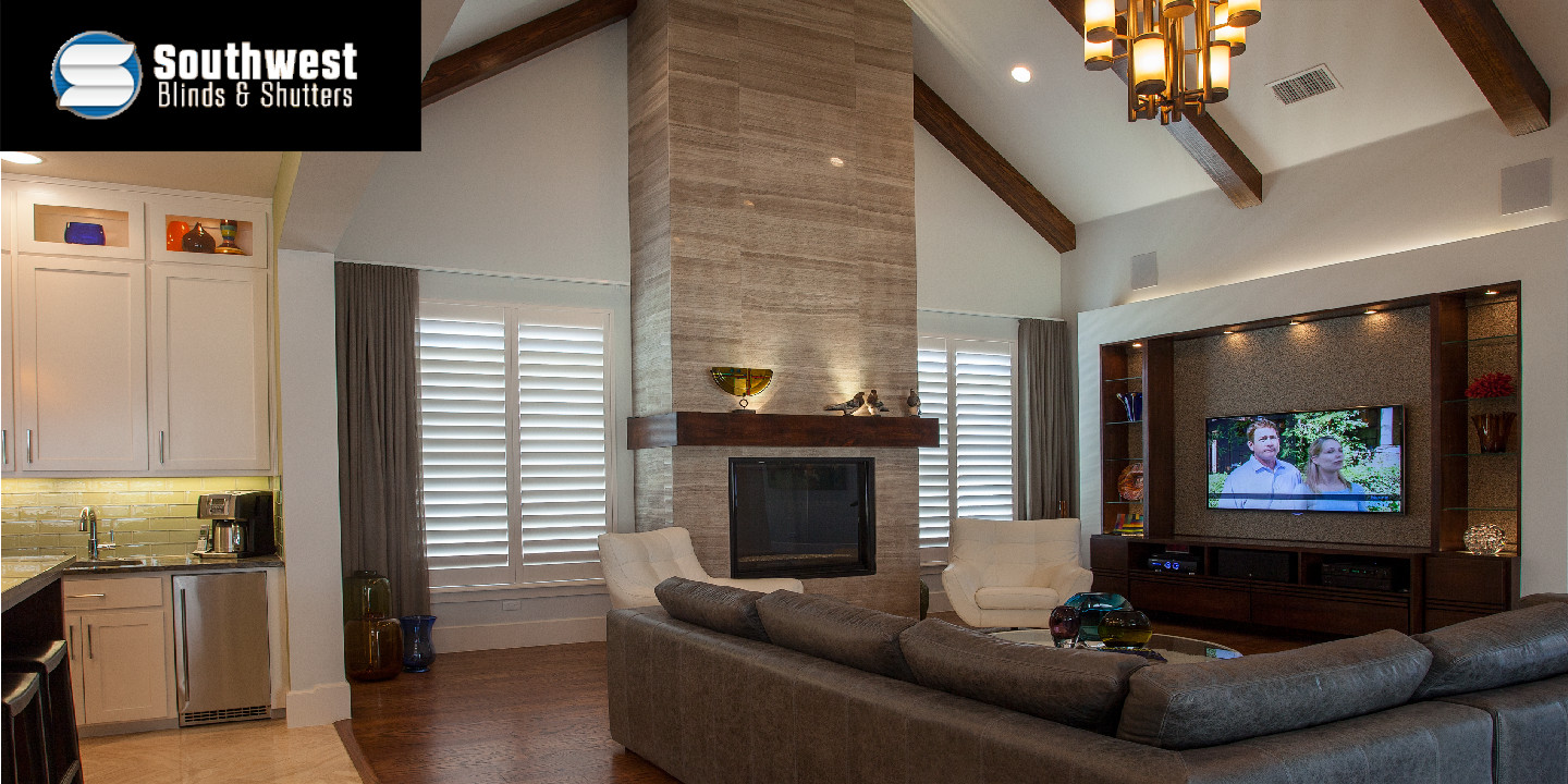 Living Area with Fireplace and Shuttered Windows